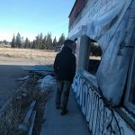 Konn Lavery at a abandoned gas station on the side of a highway Canada